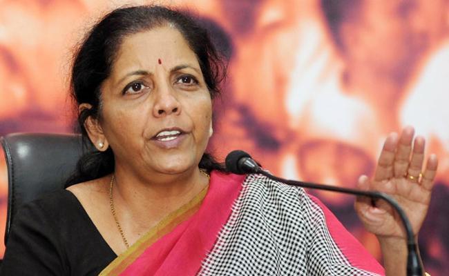 Nirmala sitharaman slams karnataka minister mahesh - Sakshi