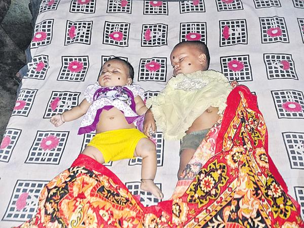 Mother suicide with her two daughters for harassment  - Sakshi