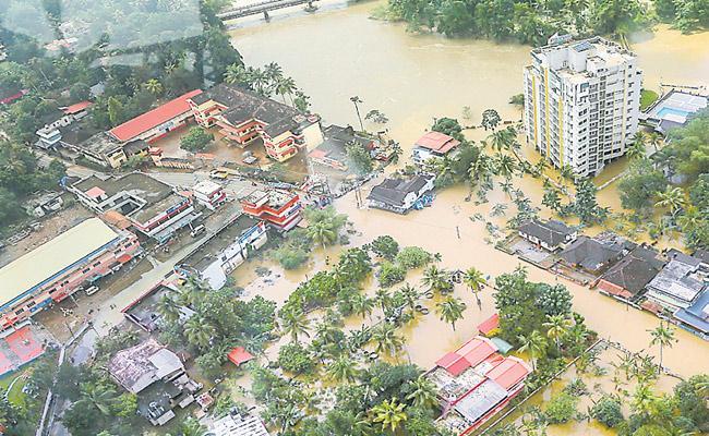 Politics On Kerala Floods - Sakshi