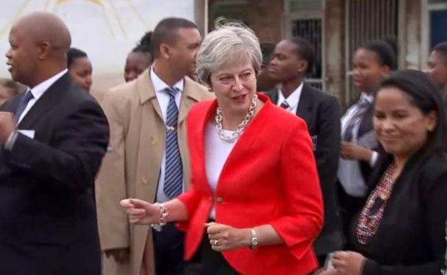 British PM Theresa May Super Awkward Dance - Sakshi