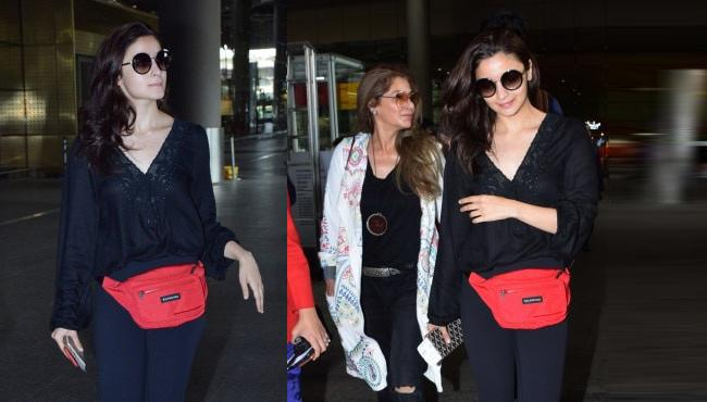 Alia Bhatt Adds Red Bag To All Black Airport Look - Sakshi