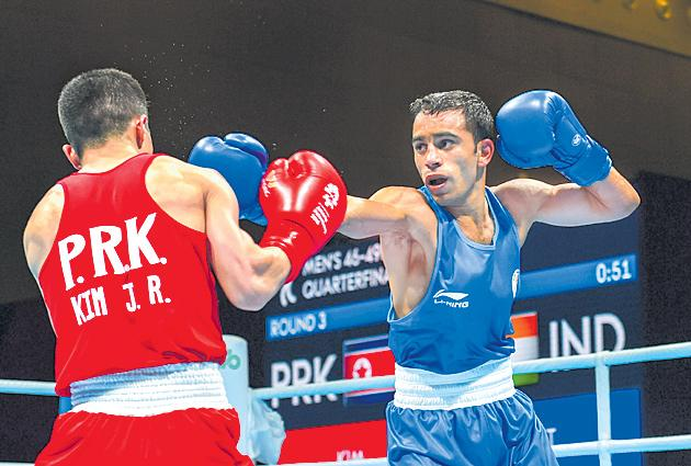 Asian Games: Boxer Vikas Krishan storms into quarters - Sakshi