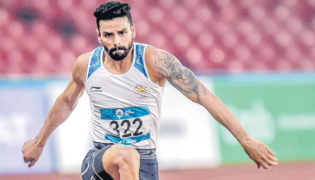 Swapna Barman and Arpinder Singh continue India's athletics gold rush - Sakshi