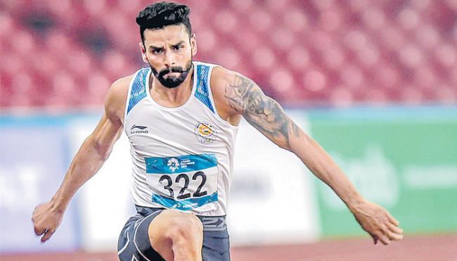 Swapna Barman and Arpinder Singh continue India's athletics gold rush - Sakshi