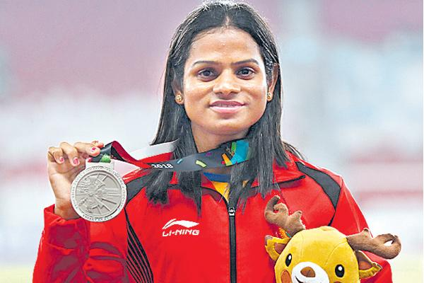 Dutee Chand Journey From Fighting Regulations to Asiad Silvers - Sakshi
