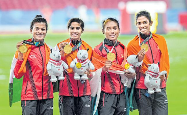 Asian Games 2018: Hima Das Leads The Pack As India Clinch Gold In Women's 4x400m Relay - Sakshi