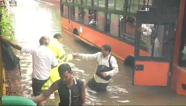 After Heavy Rain In Delhi, Roads Flooded, Long Traffic Jams - Sakshi