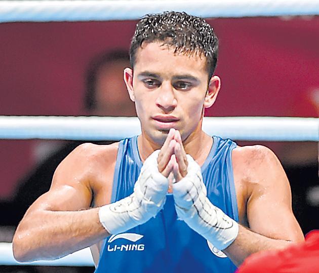 Indian boxer Amit Bhagal - Sakshi