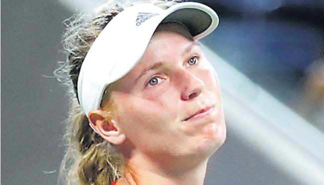 No. 2 Caroline Wozniacki follows No. 1 Simona Halep on way out - Sakshi