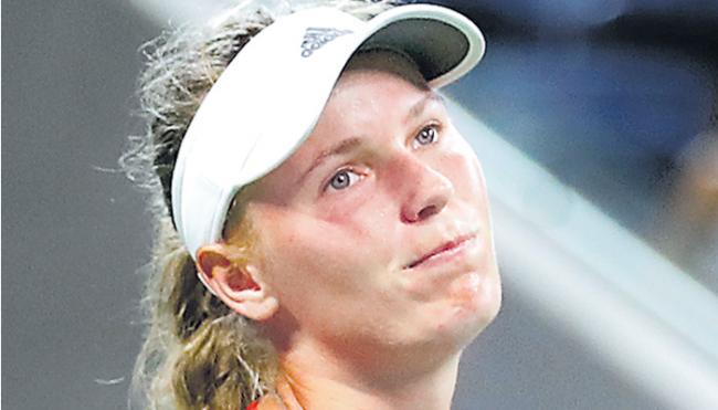 No. 2 Caroline Wozniacki follows No. 1 Simona Halep on way out - Sakshi