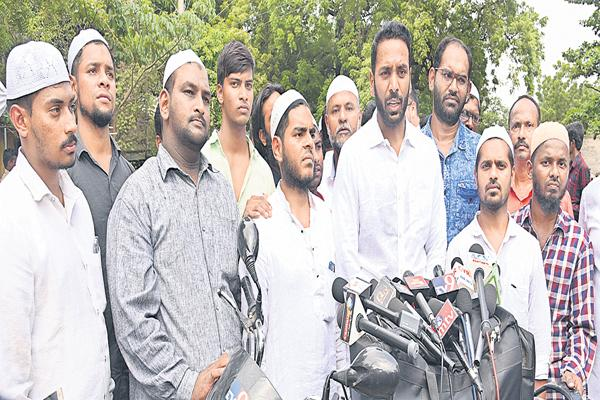 Police over action on Nandyal Muslim youth - Sakshi