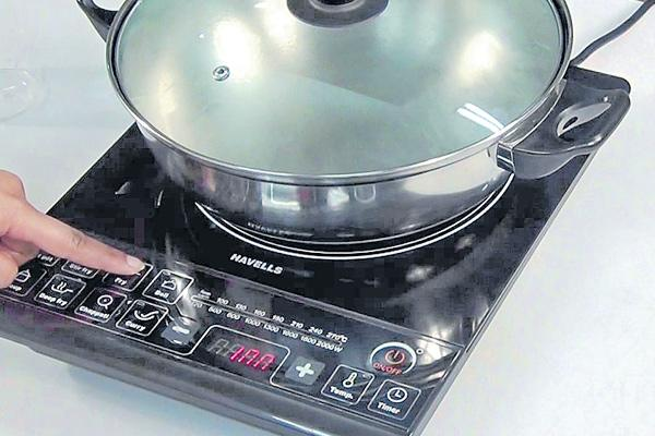 Induction stove and  precautions - Sakshi