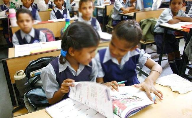 Government Employees Child Educate In Government Schools Karnataka - Sakshi
