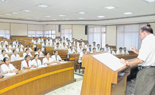 No Hike In Retirement Age Of Teaching Staff In Government College - Sakshi