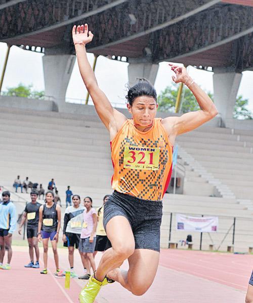 Sonam gets Gold Medal in Open Athletics Tourney - Sakshi