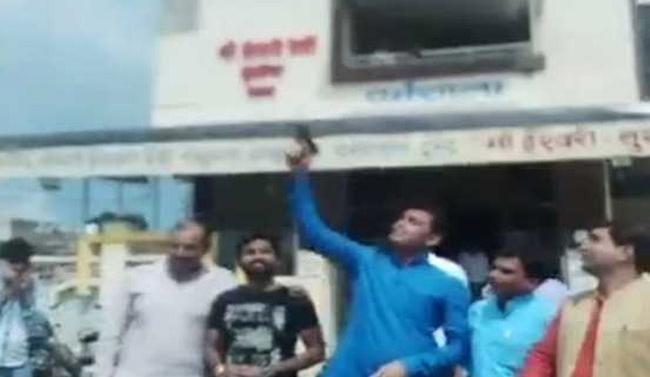 BJP Youth Wing Leaders Fire Celebratory Shots In Air - Sakshi