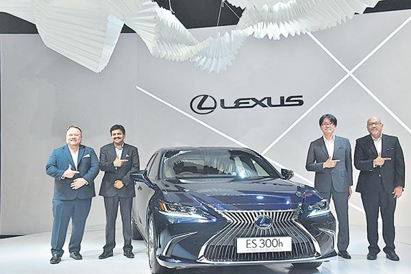 Lexus launches all-new version of hybrid electric car ES 300h in India - Sakshi