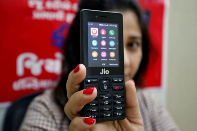Whatsapp Arrives On Jio  Phone Record sales - Sakshi