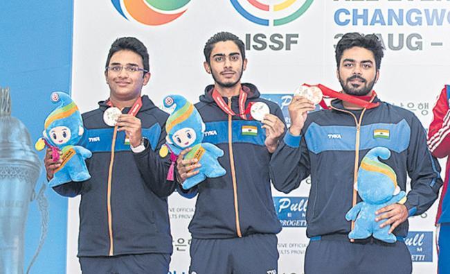 Bronze for Garcha in world shooting championship - Sakshi