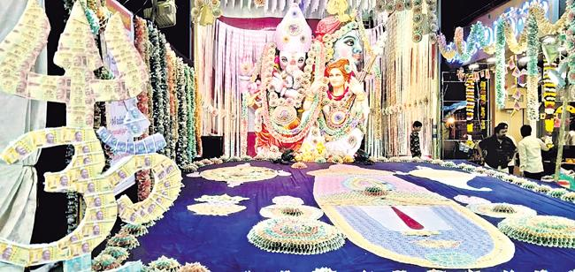 Ganesha Idol Decorated With One And Half Crore Currency Notes - Sakshi