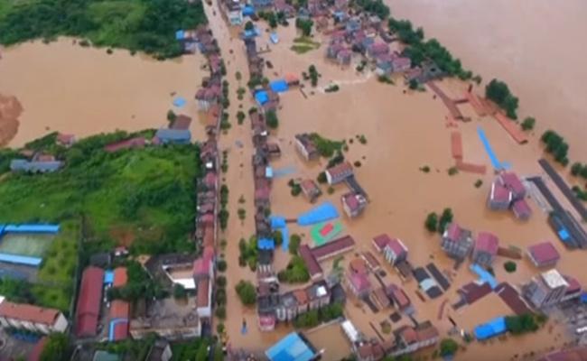 Five Killed In China Floods  - Sakshi