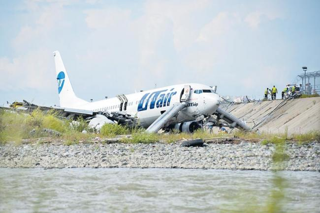 Russian plane crashes off runway in Sochi - Sakshi