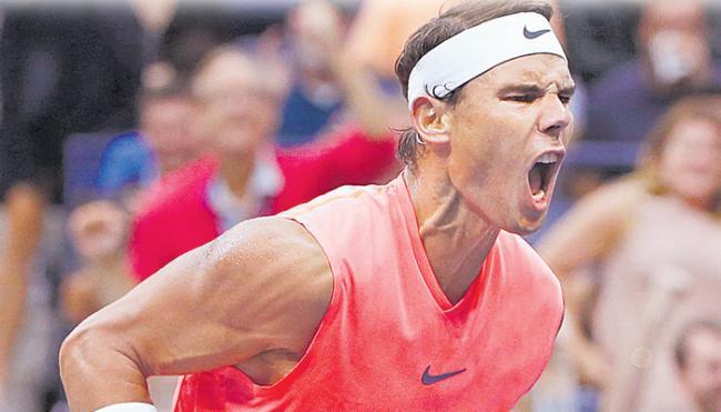 Us open:Rafael Nadal reach the quarter final - Sakshi
