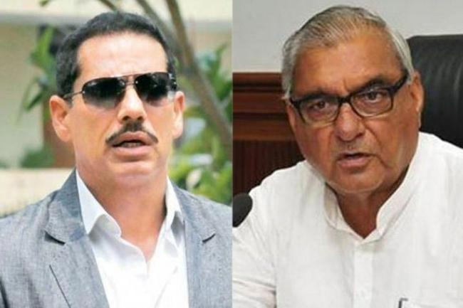 Robert Vadra, Bhupinder Singh Hooda booked for land scam - Sakshi