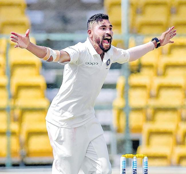 Mohammed Siraj 8 for 59 spoils Australia's day  - Sakshi