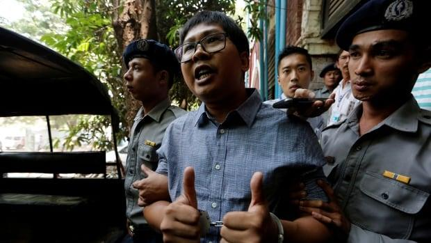 Reuters reporters sentenced to seven years in a Myanmar prison - Sakshi