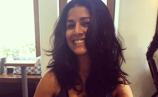 Nimrat Kaur Breaks Her Silence on Dating Rumours with Indian Coach - Sakshi