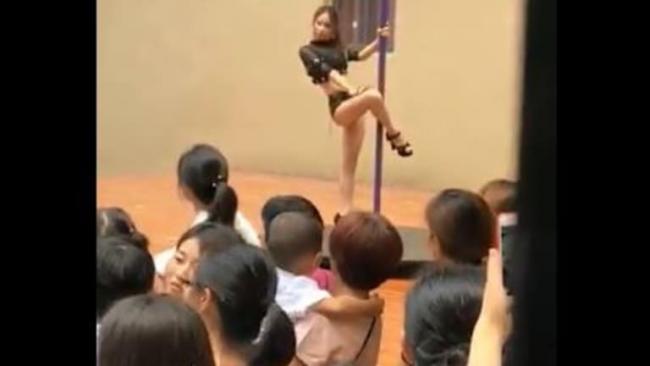 Chinese School Principal Welcoming Kids With Pole Dance - Sakshi