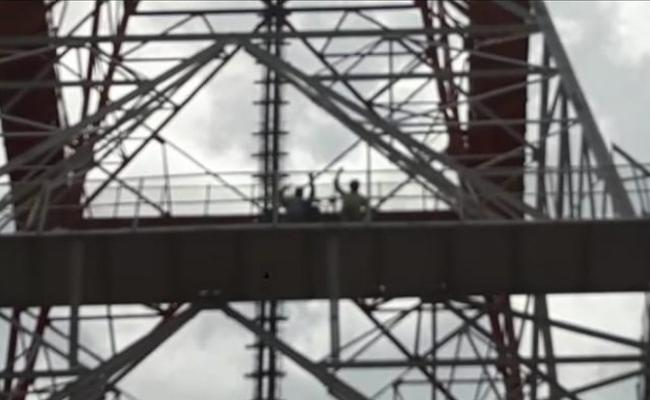Two Members Climbs Cell Tower Demanding Gives MLA Ticket For Shankaramma - Sakshi