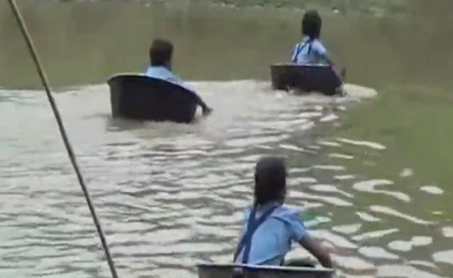 Children Cross River In Aluminium Pots To Reach School - Sakshi