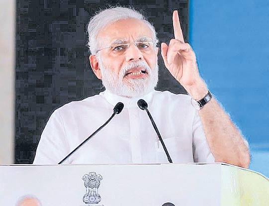 PM Modi interacts with BJP Karyakartas via video conference - Sakshi