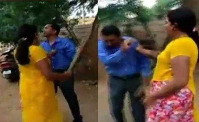 Woman thrashes a bank manager for moleting her - Sakshi