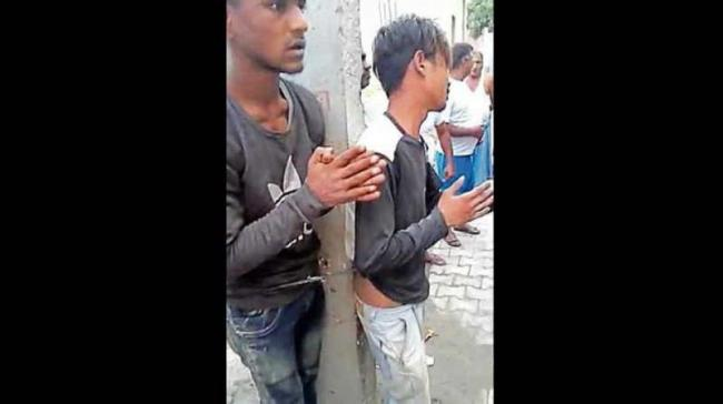 In Ghaziabad Two Men Tied To Electricity Pole Beaten For Stealing - Sakshi