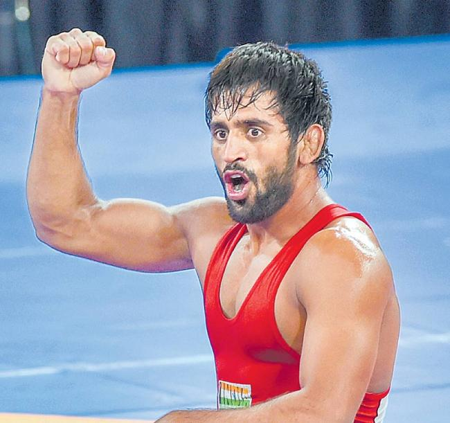 Bajrang Punia reaches semifinals at World Wrestling Championship - Sakshi