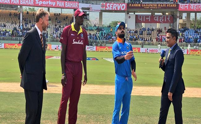 India WIn The Toss And Chose To Bat First Against West Indies - Sakshi