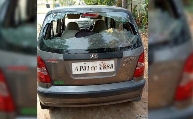 Unknown People Broken Telugu Teacher Car In Visakhapatnam - Sakshi