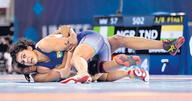 Pooja Dhanda wins bronze medal in 57kg category - Sakshi