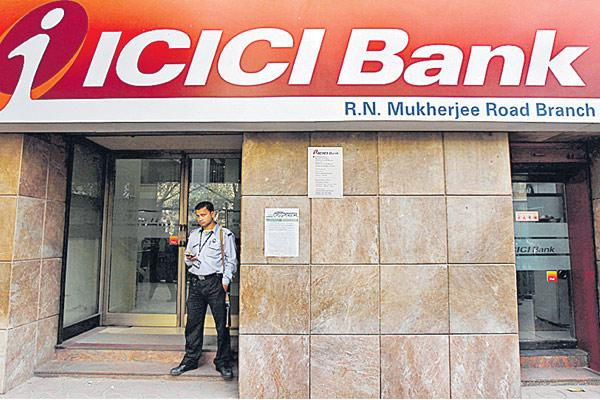 ICICI posts 56% drop in Q2 profit on rising NPAs, treasury loss - Sakshi