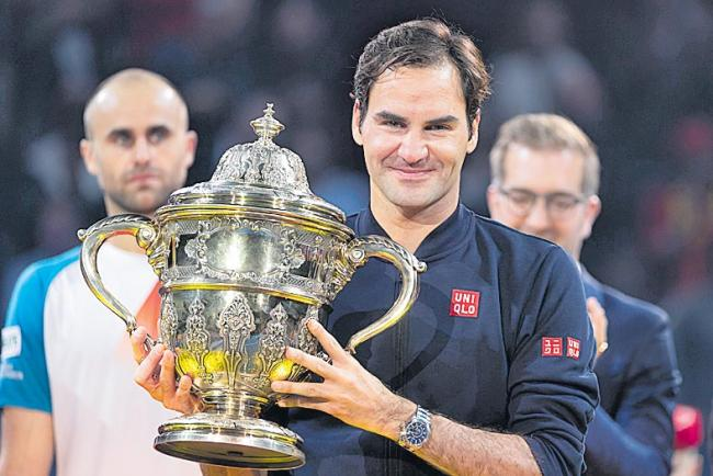 Federer wins 99th title, beats Copil in Swiss Indoors final - Sakshi