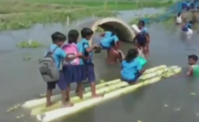 Students Going To School In Banana Stems To Cross Floods In Assam - Sakshi