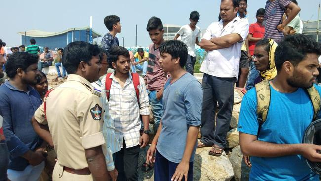AU Student Missing In Sea - Sakshi
