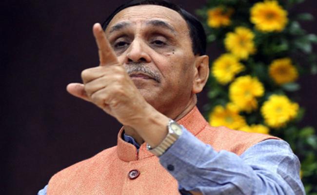 Gujarat CM Vijay Rupani Fires On Rahul Gandhi - Sakshi