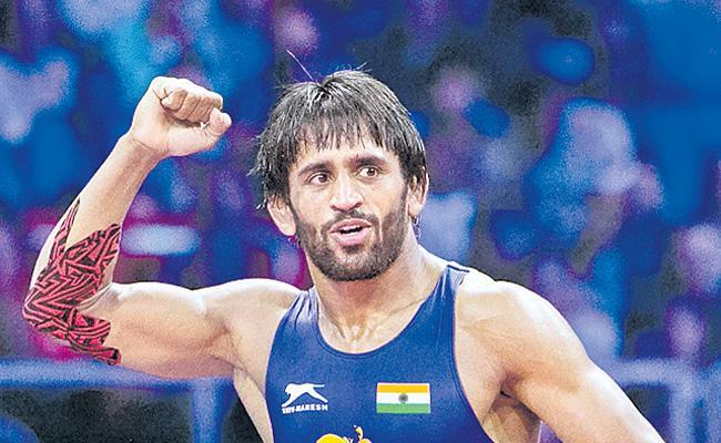 Indian star wrestler Bajrangi Poonia has achieved another rare feat. - Sakshi