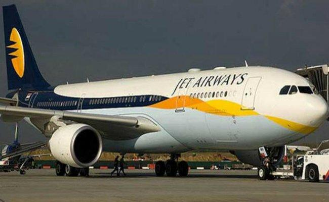 Hit by fuel costs, Jet posts 3rd straight quarterly loss at Rs 12.97 bn  - Sakshi