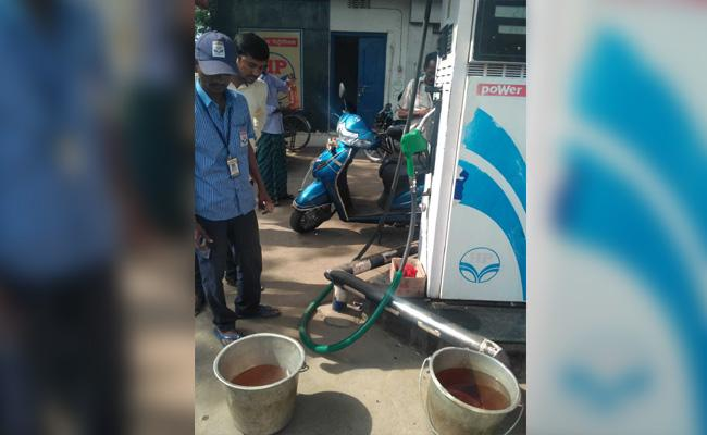 Water In Power Petrol Bunk Vizianagaram - Sakshi