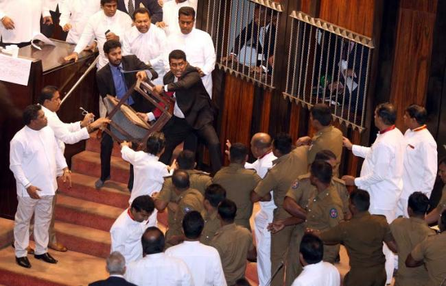 Chilli powder and chairs thrown in Sri Lanka parliament on second day - Sakshi